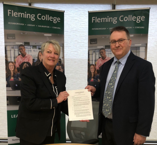 Picture of Board of Governors Chair, Dan Marinigh and President, Maureen Adamson with the signed new governing by-laws for the College today. The by-laws were unanimously approved by the Board and will be a cornerstone to Fleming's future and commitment to best practice in governance and board oversight.