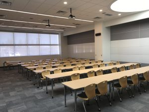 Photo of tables and chairs. Standard furniture for comfortable ease of use for students.